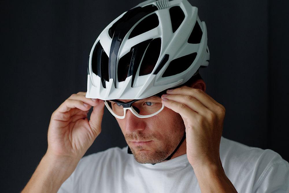 man adjusting sports glasses
