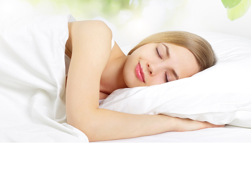 young woman sleeping with a smile